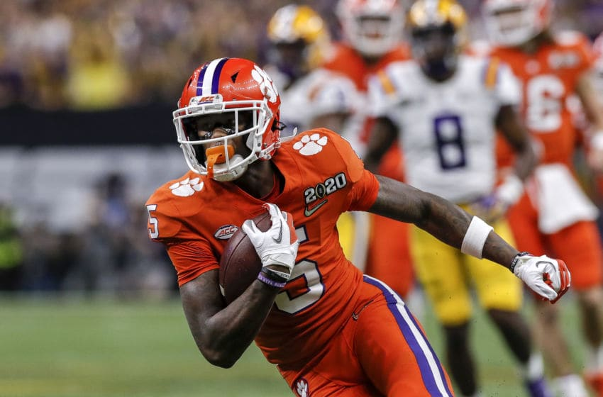 NEW ORLEANS, LA - JANUARY 13: Wide Receiver Tee Higgins #5 of the Clemson Tigers on a catch and run during the College Football Playoff National Championship game against the LSU Tigers at the Mercedes-Benz Superdome on January 13, 2020 in New Orleans, Louisiana. LSU defeated Clemson 42 to 25. (Photo by Don Juan Moore/Getty Images)
