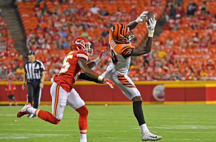 KANSAS CITY, MO - AUGUST 10: Auden Tate #19 of the Cincinnati Bengals catches a pass against Michael Hunter #25 of the Kansas City Chiefs in the fourth quarter during a preseason game at Arrowhead Stadium on August 10, 2019 in Kansas City, Missouri. (Photo by Peter Aiken/Getty Images)