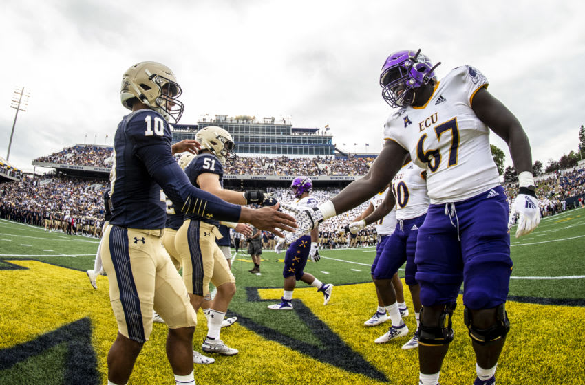 Malcom Perry #10 of the Navy Midshipmen shakes hands with D'Ante Smith #67 of the East Carolina Pirates (Photo by Benjamin Solomon/Getty Images)
