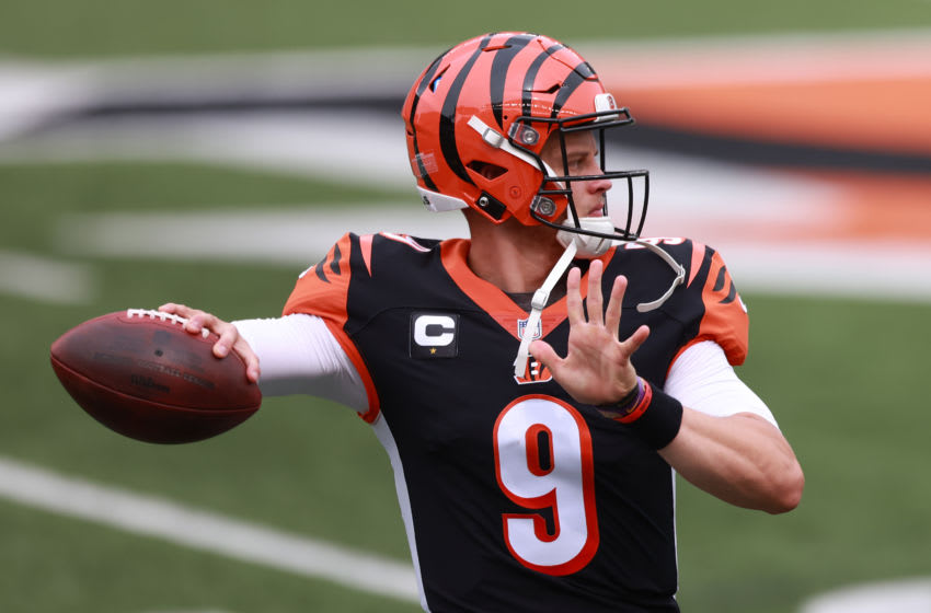 CINCINNATI, OHIO - SEPTEMBER 13: Quarterback Joe Burrow #9 of the Cincinnati Bengals throws a pass as he warms up before playing against the Los Angeles Chargers at Paul Brown Stadium on September 13, 2020 in Cincinnati, Ohio. (Photo by Bobby Ellis/Getty Images)