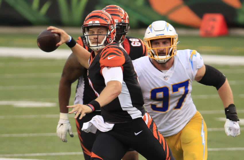 CINCINNATI, OHIO - SEPTEMBER 13: Quarterback Joe Burrow #9 of the Cincinnati Bengals looks to pass against the Los Angeles Chargers during the second half at Paul Brown Stadium on September 13, 2020 in Cincinnati, Ohio. (Photo by Andy Lyons/Getty Images)