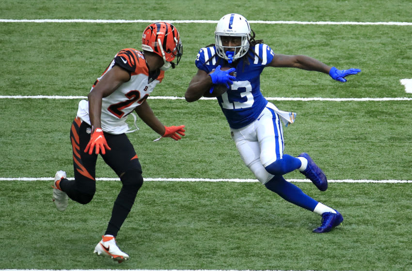 INDIANAPOLIS, INDIANA - OCTOBER 18: T.Y. Hilton #13 of the Indianapolis Colts runs the ball against William Jackson III #22 of the Cincinnati Bengals during the first half at Lucas Oil Stadium on October 18, 2020 in Indianapolis, Indiana. (Photo by Andy Lyons/Getty Images)