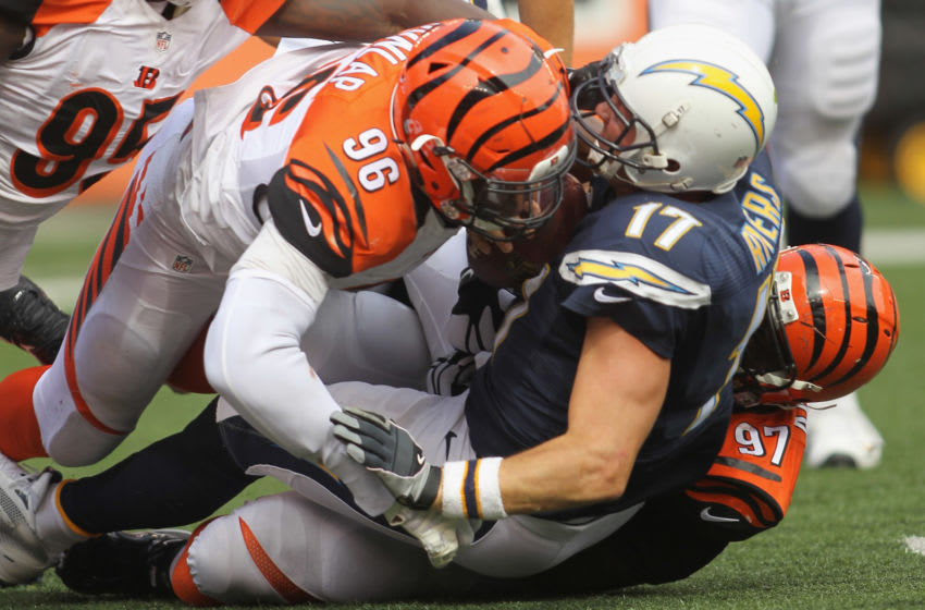 CINCINNATI, OH - SEPTEMBER 20: Carlos Dunlap #96 of the Cincinnati Bengals makes the tackle on Philip Rivers #17 of the San Diego Chargers during their game at Paul Brown Stadium on September 20, 2015 in Cincinnati, Ohio. The Bengals defeated the Chargers 24-19. (Photo by John Grieshop/Getty Images)
