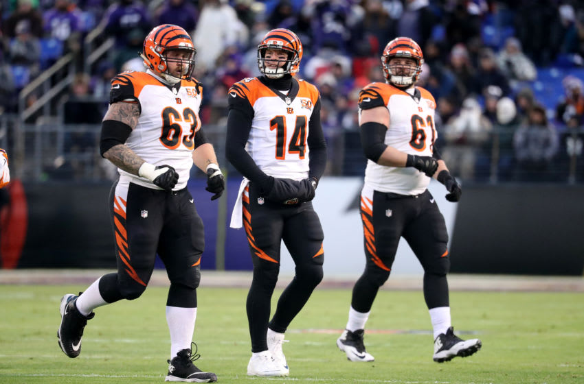 BALTIMORE, MD - DECEMBER 31: Quarterback Andy Dalton #14 of the Cincinnati Bengals walks off the field with guard Christian Westerman #63 and center Russell Bodine #61 against the Baltimore Ravens at M&T Bank Stadium on December 31, 2017 in Baltimore, Maryland. (Photo by Rob Carr/Getty Images)