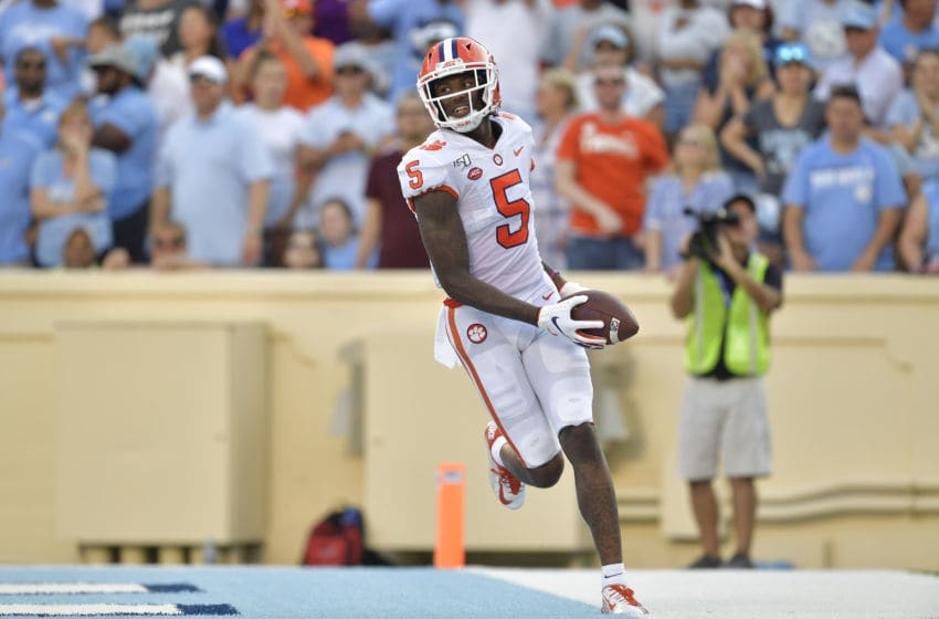 CHAPEL HILL, NORTH CAROLINA - SEPTEMBER 28: Tee Higgins #5 of the Clemson Tigers scores a touchdown against the North Carolina Tar Heels during their game at Kenan Stadium on September 28, 2019 in Chapel Hill, North Carolina. Clemson won 21-20. (Photo by Grant Halverson/Getty Images)