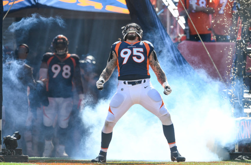 DENVER, CO - OCTOBER 13: Derek Wolfe #95 of the Denver Broncos runs onto the field during starting defense player introductions before a game against the Tennessee Titans at Empower Field at Mile High on October 13, 2019 in Denver, Colorado. (Photo by Dustin Bradford/Getty Images)