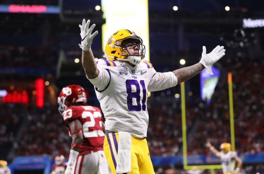 ATLANTA, GEORGIA - DECEMBER 28: Tight end Thaddeus Moss #81 of the LSU Tigers celebrates a touchdown in the second quarter over the Oklahoma Sooners during the Chick-fil-A Peach Bowl at Mercedes-Benz Stadium on December 28, 2019 in Atlanta, Georgia. (Photo by Gregory Shamus/Getty Images)