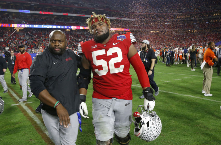 GLENDALE, ARIZONA - DECEMBER 28: Offensive lineman Wyatt Davis #52 of the Ohio State Buckeyes walks off the field after his teams 29-23 loss to the Clemson Tigers in the College Football Playoff Semifinal at the PlayStation Fiesta Bowl at State Farm Stadium on December 28, 2019 in Glendale, Arizona. (Photo by Ralph Freso/Getty Images)