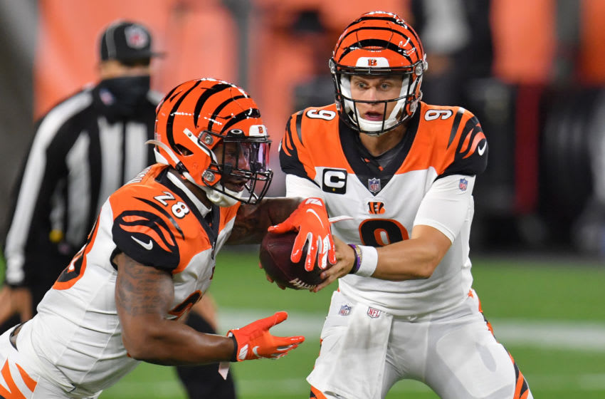 CLEVELAND, OHIO - SEPTEMBER 17: Joe Burrow #9 hands off to Joe Mixon #28 of the Cincinnati Bengals during the first quarter against the Cleveland Browns at FirstEnergy Stadium on September 17, 2020 in Cleveland, Ohio. (Photo by Jason Miller/Getty Images)