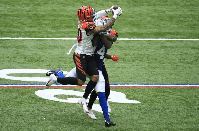 INDIANAPOLIS, INDIANA - OCTOBER 18: Jessie Bates III #30 of the Cincinnati Bengals intercepts a ball intended for Zach Pascal #14 of the Indianapolis Colts during the second half at Lucas Oil Stadium on October 18, 2020 in Indianapolis, Indiana. (Photo by Andy Lyons/Getty Images)