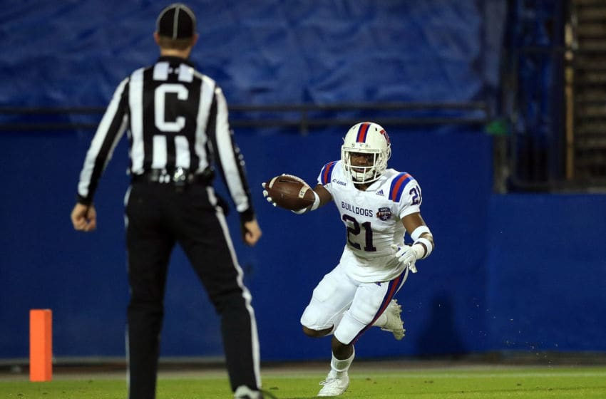 FRISCO, TX - DECEMBER 20: Amik Robertson #21 of the Louisiana Tech Bulldogs scores a touchdown on a interception against the Southern Methodist Mustangs in the first quarter during the 2017 DXL Frisco Bowl on December 20, 2017 in Frisco, Texas. (Photo by Ronald Martinez/Getty Images)