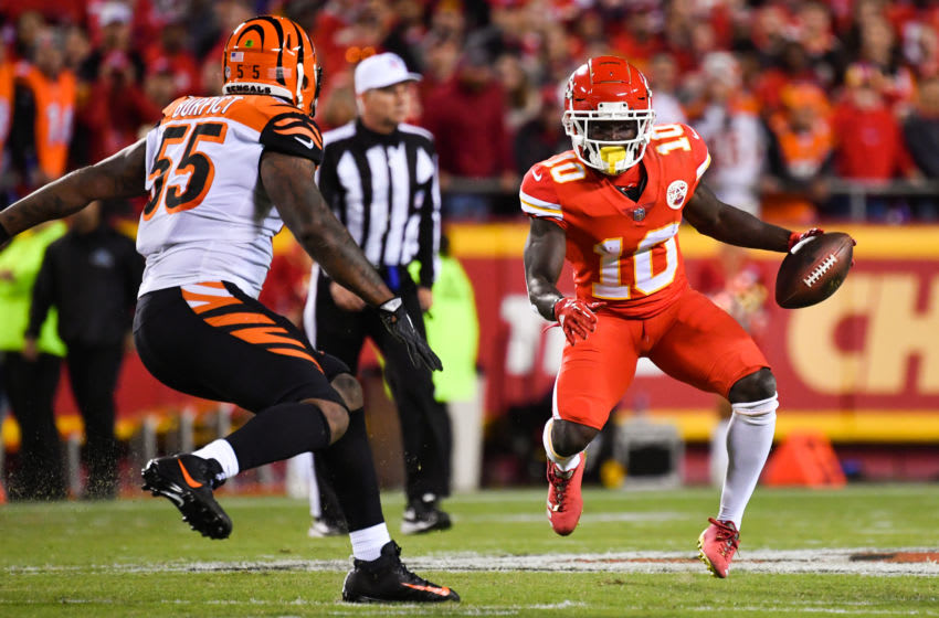 KANSAS CITY, MO - OCTOBER 21: Tyreek Hill #10 of the Kansas City Chiefs begins to make a hard cut in in front of Vontaze Burfict #55 of the Cincinnati Bengals during the first quarter of the game at Arrowhead Stadium on October 21, 2018 in Kansas City, Kansas. (Photo by Peter Aiken/Getty Images)