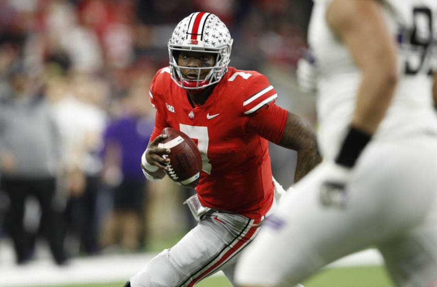 INDIANAPOLIS, INDIANA - DECEMBER 01: Dwayne Haskins Jr. #7 of the Ohio State Buckeyes runs the ball against the Northwestern Wildcats in the fourth quarter at Lucas Oil Stadium on December 01, 2018 in Indianapolis, Indiana. (Photo by Joe Robbins/Getty Images)