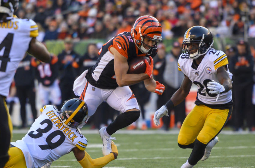 CINCINNATI, OH - NOVEMBER 24: Alex Erickson #12 of the Cincinnati Bengals runs with the ball during the third quarter of the game against the Pittsburgh Steelers at Paul Brown Stadium on November 24, 2019 in Cincinnati, Ohio. (Photo by Bobby Ellis/Getty Images)
