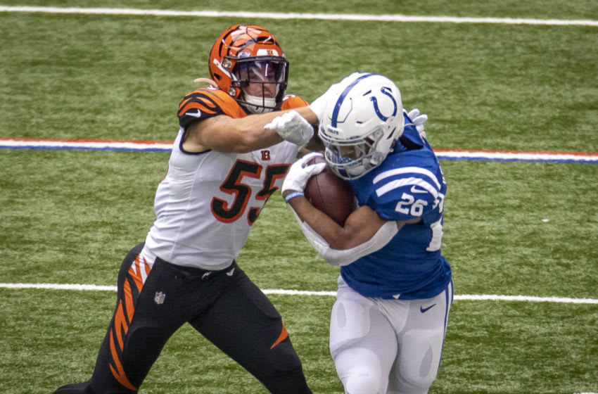 INDIANAPOLIS, IN - OCTOBER 18: Jonathan Taylor #28 of the Indianapolis Colts is pushed out of bounds by Logan Wilson #55 of the Cincinnati Bengals during the first quarter of the game at Lucas Oil Stadium on October 18, 2020 in Indianapolis, Indiana. (Photo by Bobby Ellis/Getty Images)