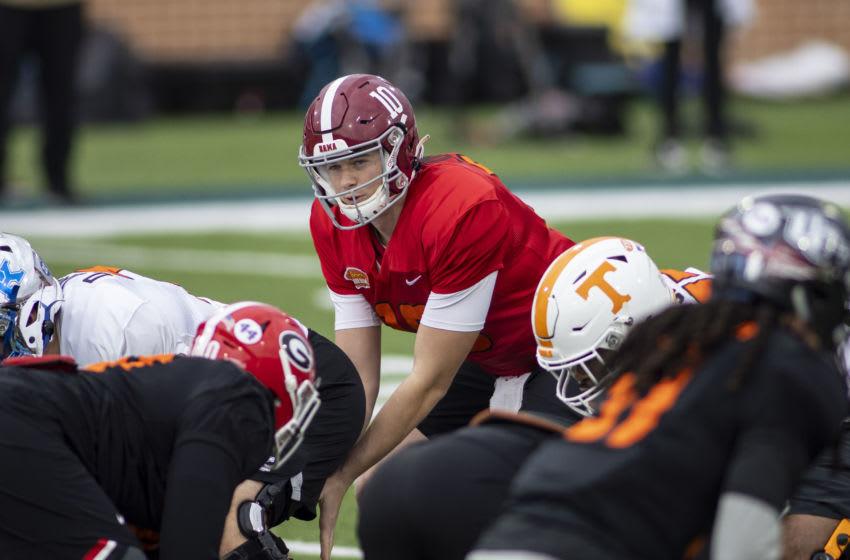 Jan 26, 2021; Mobile, Alabama, USA; American quarterback Mac Jones of Alabama (10) runs a play in drills during National team practice during the 2021 Senior Bowl week. Mandatory Credit: Vasha Hunt-USA TODAY Sports