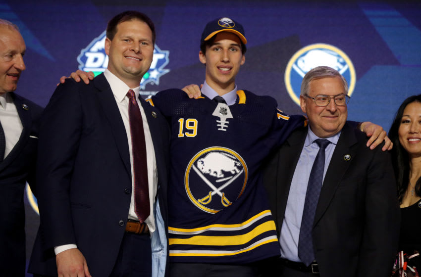 VANCOUVER, BRITISH COLUMBIA - JUNE 21: Dylan Cozens reacts after being selected seventh overall by the Buffalo Sabres during the first round of the 2019 NHL Draft at Rogers Arena on June 21, 2019 in Vancouver, Canada. (Photo by Bruce Bennett/Getty Images)