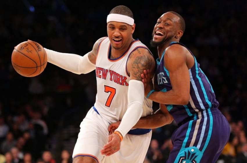 Apr 6, 2016; New York, NY, USA; New York Knicks small forward Carmelo Anthony (7) drives against Charlotte Hornets point guard Kemba Walker (15) during the fourth quarter at Madison Square Garden. Mandatory Credit: Brad Penner-USA TODAY Sports