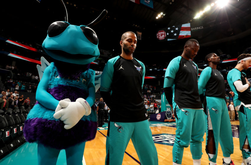 CHARLOTTE, NC - OCTOBER 2: Tony Parker #9 of the Charlotte Hornets stands for the National Anthem before a pre-season game against the Miami Heat on October 2, 2018 at Spectrum Center in Charlotte, North Carolina. NOTE TO USER: User expressly acknowledges and agrees that, by downloading and/or using this Photograph, user is consenting to the terms and conditions of the Getty Images License Agreement. Mandatory Copyright Notice: Copyright 2018 NBAE (Photo by Kent Smith/NBAE via Getty Images)