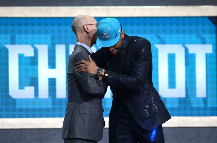 NEW YORK, NEW YORK - JUNE 20: PJ Washington poses with NBA Commissioner Adam Silver after being drafted with the 12th overall pick by the Charlotte Hornets during the 2019 NBA Draft at the Barclays Center on June 20, 2019 in the Brooklyn borough of New York City. NOTE TO USER: User expressly acknowledges and agrees that, by downloading and or using this photograph, User is consenting to the terms and conditions of the Getty Images License Agreement. (Photo by Sarah Stier/Getty Images)
