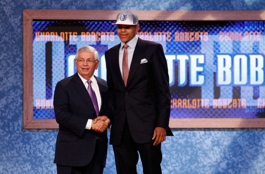 NEWARK, NJ - JUNE 23: Tobias Harris of the Tennessee Volunteers greets NBA Commissioner David Stern after he was selected #19 overall by the Charlotte Bobcats in the first round during the 2011 NBA Draft at the Prudential Center on June 23, 2011 in Newark, New Jersey. NOTE TO USER: User expressly acknowledges and agrees that, by downloading and/or using this Photograph, user is consenting to the terms and conditions of the Getty Images License Agreement. (Photo by Mike Stobe/Getty Images)
