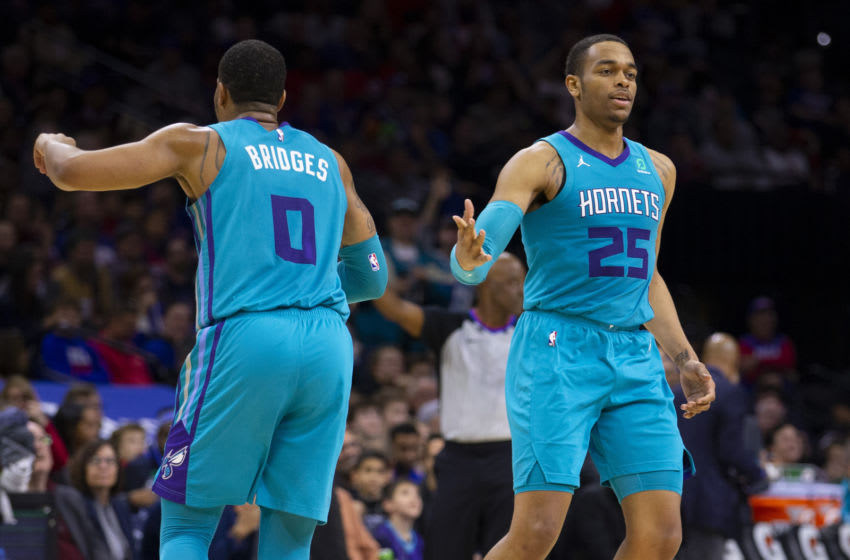 PHILADELPHIA, PA - NOVEMBER 10: Miles Bridges #0 and PJ Washington #25 of the Charlotte Hornets react against the Philadelphia 76ers at the Wells Fargo Center on November 10, 2019 in Philadelphia, Pennsylvania. The 76ers defeated the Hornets 114-106. NOTE TO USER: User expressly acknowledges and agrees that, by downloading and/or using this photograph, user is consenting to the terms and conditions of the Getty Images License Agreement. (Photo by Mitchell Leff/Getty Images)