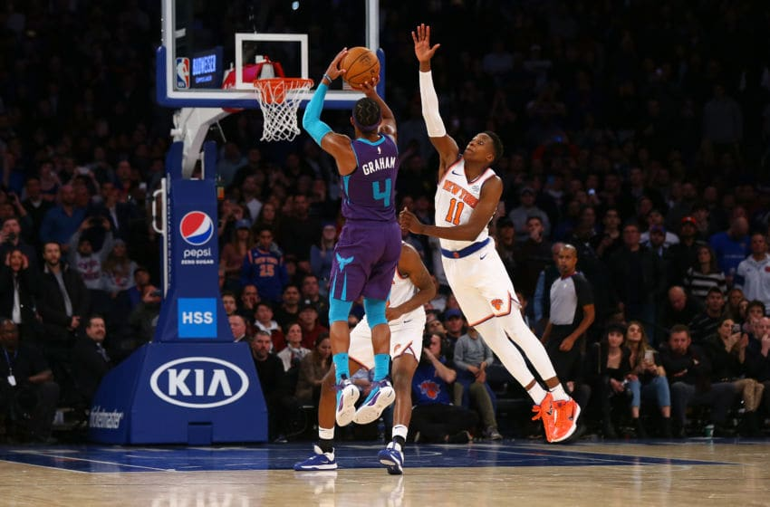 NEW YORK, NEW YORK - NOVEMBER 16: Devonte' Graham #4 of the Charlotte Hornets hits a three point basket with 2 seconds left in the fourth quarter to win the game against the New York Knicks at Madison Square Garden on November 16, 2019 in New York City. Charlotte Hornets defeated the Charlotte Hornets 103-102. NOTE TO USER: User expressly acknowledges and agrees that, by downloading and or using this photograph, User is consenting to the terms and conditions of the Getty Images License Agreement. (Photo by Mike Stobe/Getty Images)
