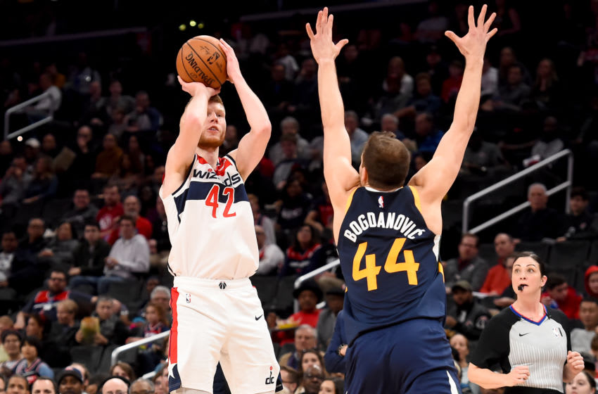 WASHINGTON, DC - JANUARY 12: Davis Bertans #42 of the Washington Wizards shoots in front of Bojan Bogdanovic #44 of the Utah Jazz during the game at Capital One Arena on January 12, 2020 in Washington, DC. NOTE TO USER: User expressly acknowledges and agrees that, by downloading and or using this photograph, User is consenting to the terms and conditions of the Getty Images License Agreement. (Photo by Will Newton/Getty Images)