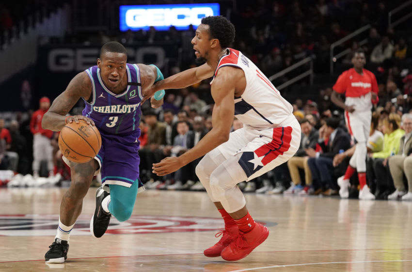WASHINGTON, DC - JANUARY 30: Terry Rozier #3 of the Charlotte Hornets dribbles against Ish Smith #14 of the Washington Wizards in the first half at Capital One Arena on January 30, 2020 in Washington, DC. NOTE TO USER: User expressly acknowledges and agrees that, by downloading and or using this photograph, User is consenting to the terms and conditions of the Getty Images License Agreement. (Photo by Patrick McDermott/Getty Images)