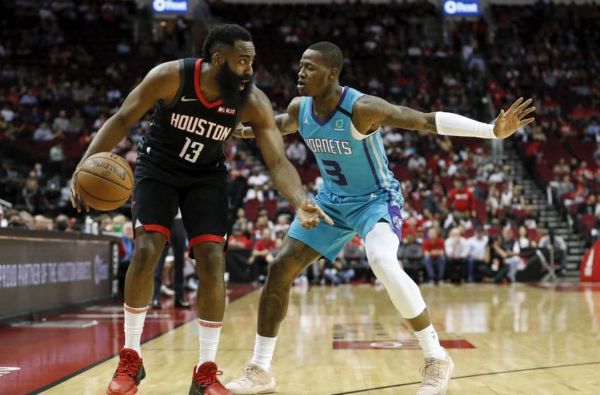 Charlotte Hornets Terry Rozier guards James Harden. (Photo by Tim Warner/Getty Images)