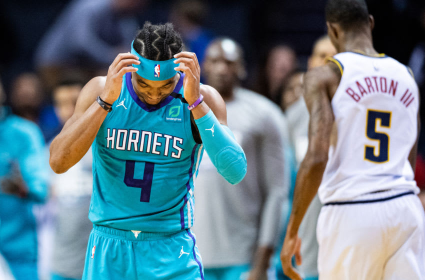 CHARLOTTE, NORTH CAROLINA - MARCH 05: Devonte' Graham #4 of the Charlotte Hornets reacts after a play during the fourth quarter during their game against the Denver Nuggets at Spectrum Center on March 05, 2020 in Charlotte, North Carolina. NOTE TO USER: User expressly acknowledges and agrees that, by downloading and/or using this photograph, user is consenting to the terms and conditions of the Getty Images License Agreement. (Photo by Jacob Kupferman/Getty Images)