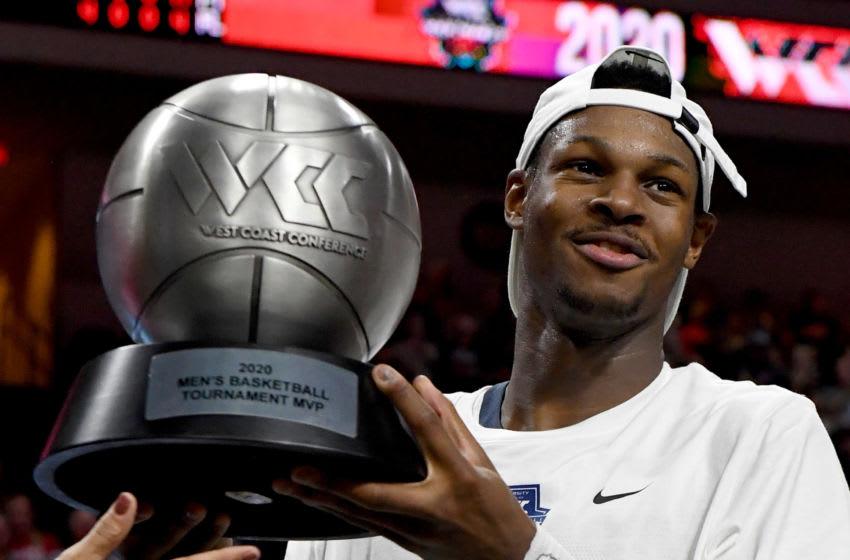 LAS VEGAS, NEVADA - MARCH 10: Joel Ayayi #11 of the Gonzaga Bulldogs holds up the most outstanding player award after the Bulldogs defeated the Saint Mary's Gaels 84-66 to win the championship game of the West Coast Conference basketball tournament at the Orleans Arena on March 10, 2020 in Las Vegas, Nevada. (Photo by Ethan Miller/Getty Images)