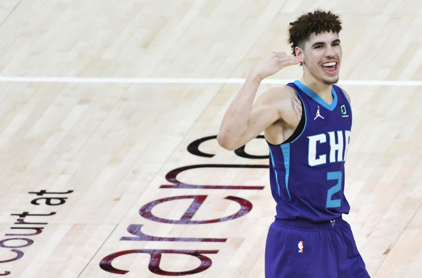 SALT LAKE CITY, UTAH - FEBRUARY 22: LaMelo Ball #2 of the Charlotte Hornets celebrates a play during a game against the Utah Jazz at Vivint Smart Home Arena on February 22, 2021 in Salt Lake City, Utah. NOTE TO USER: User expressly acknowledges and agrees that, by downloading and/or using this photograph, user is consenting to the terms and conditions of the Getty Images License Agreement. (Photo by Alex Goodlett/Getty Images)