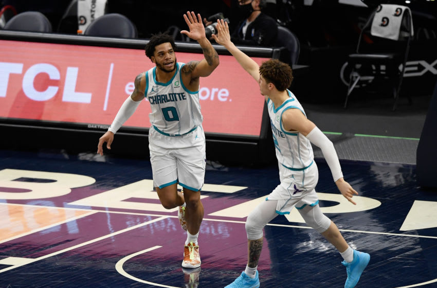 MINNEAPOLIS, MINNESOTA - MARCH 03: Miles Bridges #0 and LaMelo Ball #2 of the Charlotte Hornets celebrate a basket against the Minnesota Timberwolves during the third quarter of the game at Target Center on March 3, 2021 in Minneapolis, Minnesota. The Hornets defeated the Timberwolves 135-102. NOTE TO USER: User expressly acknowledges and agrees that, by downloading and or using this Photograph, user is consenting to the terms and conditions of the Getty Images License Agreement (Photo by Hannah Foslien/Getty Images)