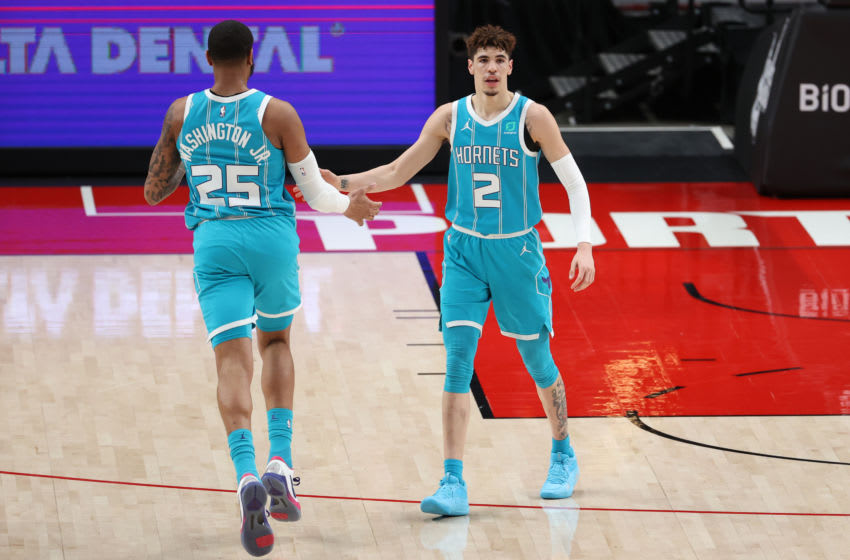 PORTLAND, OREGON - MARCH 01: P.J. Washington #25 and LaMelo Ball #2 of the Charlotte Hornets high five in the first quarter against the Portland Trail Blazers at Moda Center on March 01, 2021 in Portland, Oregon. NOTE TO USER: User expressly acknowledges and agrees that, by downloading and or using this photograph, User is consenting to the terms and conditions of the Getty Images License Agreement. (Photo by Abbie Parr/Getty Images)
