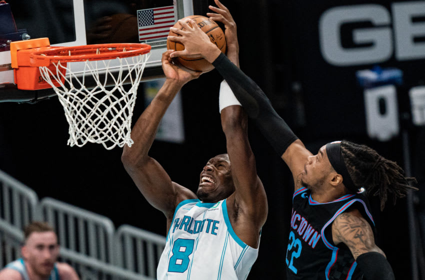 CHARLOTTE, NORTH CAROLINA - MARCH 15: Richaun Holmes #22 of the Sacramento Kings blocks the shot from Bismack Biyombo #8 of the Charlotte Hornets during the first quarter at Spectrum Center on March 15, 2021 in Charlotte, North Carolina. NOTE TO USER: User expressly acknowledges and agrees that, by downloading and or using this photograph, User is consenting to the terms and conditions of the Getty Images License Agreement. (Photo by Jacob Kupferman/Getty Images)