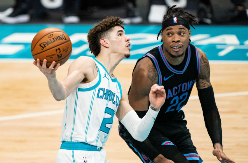 CHARLOTTE, NORTH CAROLINA - MARCH 15: LaMelo Ball #2 of the Charlotte Hornets drives to the basket against Richaun Holmes #22 of the Sacramento Kings during the third quarter at Spectrum Center on March 15, 2021 in Charlotte, North Carolina. NOTE TO USER: User expressly acknowledges and agrees that, by downloading and or using this photograph, User is consenting to the terms and conditions of the Getty Images License Agreement. (Photo by Jacob Kupferman/Getty Images)