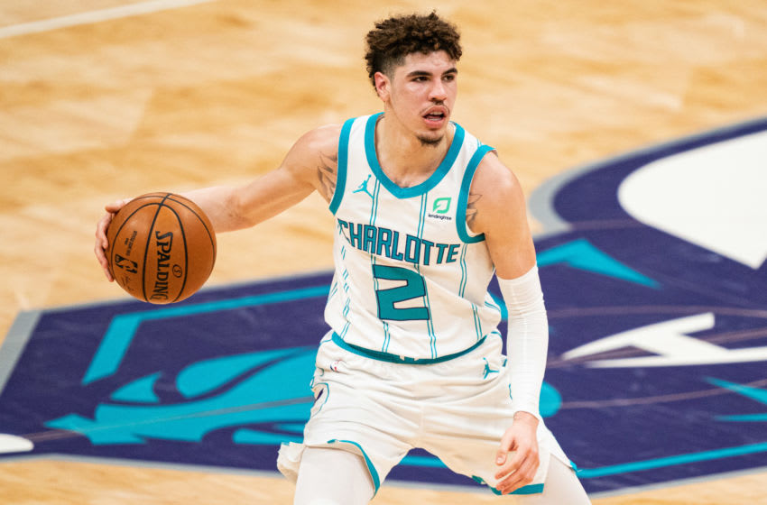 CHARLOTTE, NORTH CAROLINA - MARCH 15: LaMelo Ball #2 of the Charlotte Hornets brings the ball up court against the Sacramento Kings during the fourth quarter during their game at Spectrum Center on March 15, 2021 in Charlotte, North Carolina. NOTE TO USER: User expressly acknowledges and agrees that, by downloading and or using this photograph, User is consenting to the terms and conditions of the Getty Images License Agreement. (Photo by Jacob Kupferman/Getty Images)
