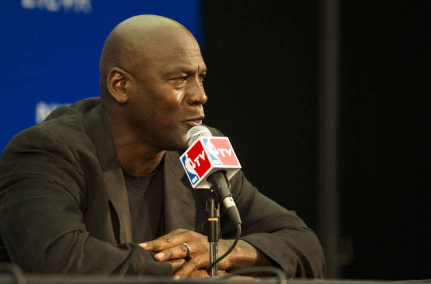 SHENZHEN, CHINA - OCTOBER 11: Michael Jordan, Owner of Charlotte Hornets speaks to media during the press conference before the match between Charlotte Hornets and Los Angeles Clippers as part of the 2015 NBA Global Games China at Universiade Centre on October 11, 2015 in Shenzhen, China. (Photo by Zhong Zhi/Getty Images)