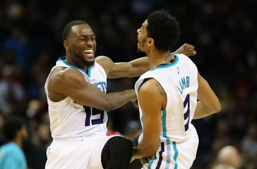 CHARLOTTE, NC - NOVEMBER 25: Kemba Walker #15 and teammate Jeremy Lamb #3 of the Charlotte Hornets react after a play during their game against the Washington Wizards at Time Warner Cable Arena on November 25, 2015 in Charlotte, North Carolina. NBA - NOTE TO USER: User expressly acknowledges and agrees that, by downloading and or using this photograph, User is consenting to the terms and conditions of the Getty Images License Agreement. (Photo by Streeter Lecka/Getty Images)
