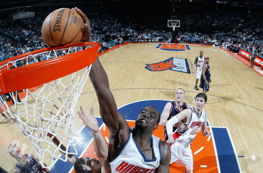 CHARLOTTE, NC - MARCH 28: Emeka Okafor #50 of the Charlotte Bobcats dunks the ball during the game against the New Jersey Nets March 28, 2005 at the Charlotte Coliseum in Charlotte, North Carolina. The Nets defeated the Bobcats 95-91. NOTE TO USER: User expressly acknowledges and agrees that, by downloading and/or using this Photograph, user is consenting to the terms and conditions of the Getty Images License Agreement. (Photo by Streeter Lecka/Getty Images)