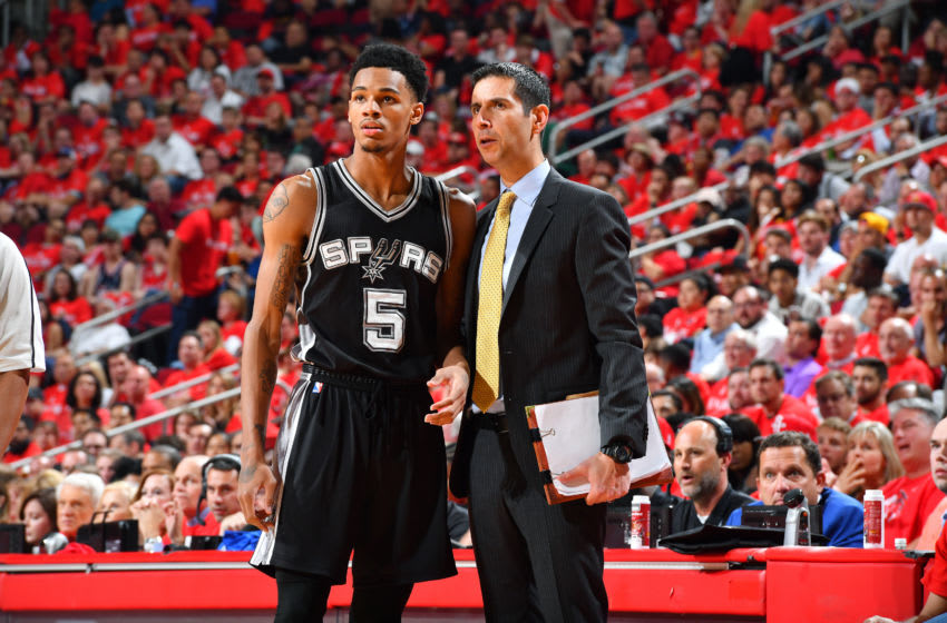 HOUSTON, TX - MAY 11: Assistant coach James Borrego of the San Antonio Spurs talks with Dejounte Murray #5 of the San Antonio Spurs during the game against the Houston Rockets during Game Six of the Western Conference Semifinals of the 2017 NBA Playoffs on May 11, 2017 at the Toyota Center in Houston, Texas. NOTE TO USER: User expressly acknowledges and agrees that, by downloading and or using this photograph, User is consenting to the terms and conditions of the Getty Images License Agreement. Mandatory Copyright Notice: Copyright 2017 NBAE (Photo by Jesse D. Garrabrant/NBAE via Getty Images)