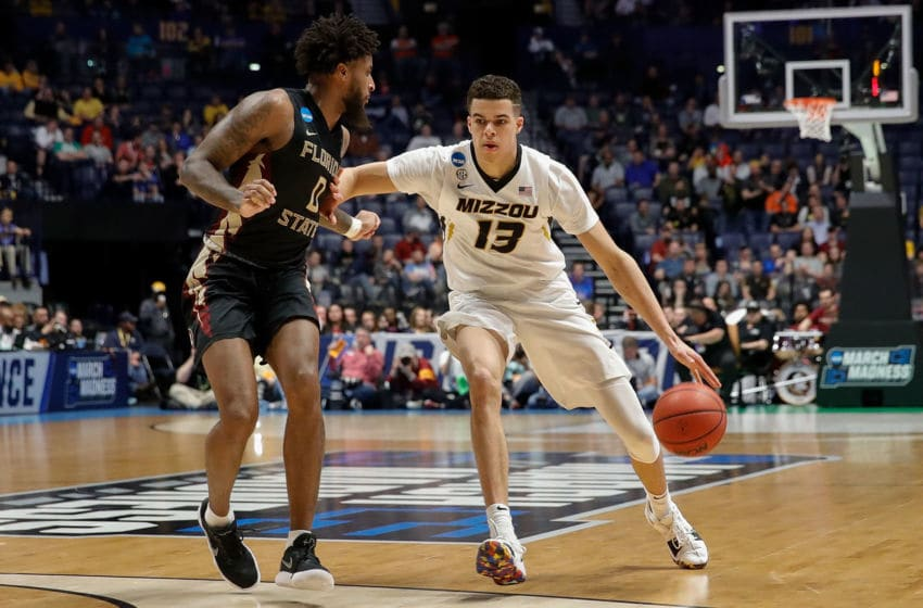 NASHVILLE, TN - MARCH 16: Michael Porter Jr. #13 of the Missouri Tigers plays against Phil Cover #00 of the Florida State Seminoles during the first round of the 2018 NCAA Men's Basketball Tournament at Bridgestone Arena on March 16, 2018 in Nashville, Tennessee. (Photo by Frederick Breedon/Getty Images)