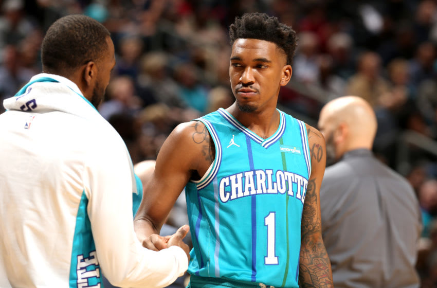 CHARLOTTE, NC - NOVEMBER 15: Malik Monk #1 and Kemba Walker #15 of the Charlotte Hornets high five during the game against the Cleveland Cavaliers on November 15, 2017 at Spectrum Center in Charlotte, North Carolina. NOTE TO USER: User expressly acknowledges and agrees that, by downloading and or using this photograph, User is consenting to the terms and conditions of the Getty Images License Agreement. Mandatory Copyright Notice: Copyright 2017 NBAE (Photo by Kent Smith/NBAE via Getty Images)