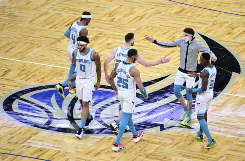 ORLANDO, FLORIDA - JANUARY 24: LaMelo Ball #2 and Gordon Hayward #20 of the Charlotte Hornets react after defeating the Orlando Magic at Amway Center on January 24, 2021 in Orlando, Florida. NOTE TO USER: User expressly acknowledges and agrees that, by downloading and or using this photograph, User is consenting to the terms and conditions of the Getty Images License Agreement. (Photo by Douglas P. DeFelice/Getty Images)
