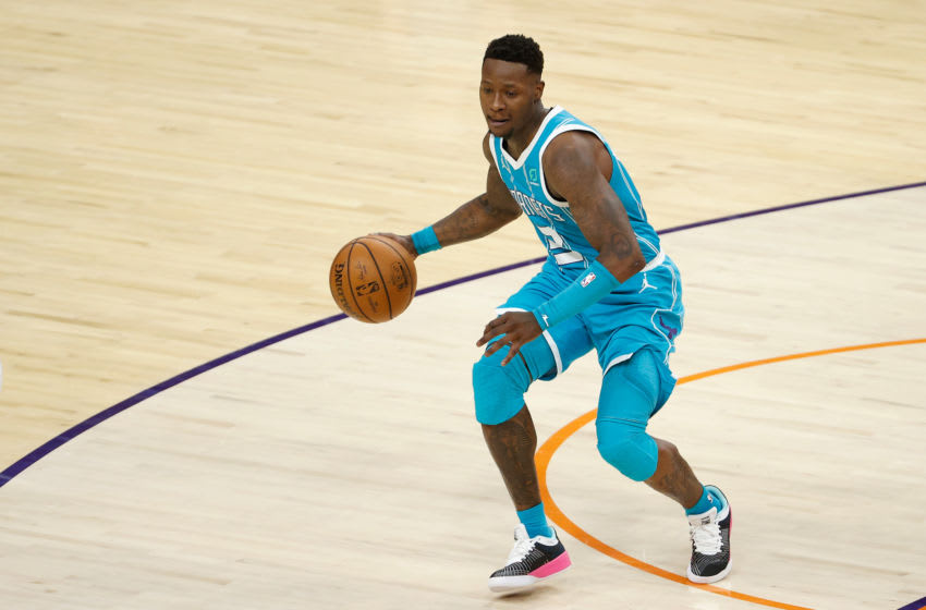 PHOENIX, ARIZONA - FEBRUARY 24: Terry Rozier #3 of the Charlotte Hornets handles the ball during the NBA game against the Phoenix Suns at Phoenix Suns Arena on February 24, 2021 in Phoenix, Arizona. The Hornets defeated the Suns 124-121. NOTE TO USER: User expressly acknowledges and agrees that, by downloading and or using this photograph, User is consenting to the terms and conditions of the Getty Images License Agreement. (Photo by Christian Petersen/Getty Images)