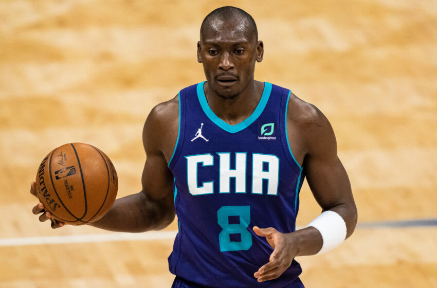 CHARLOTTE, NORTH CAROLINA - MAY 07: Bismack Biyombo #8 of the Charlotte Hornets brings the ball up court against the Orlando Magic during their game at Spectrum Center on May 07, 2021 in Charlotte, North Carolina. NOTE TO USER: User expressly acknowledges and agrees that, by downloading and or using this photograph, User is consenting to the terms and conditions of the Getty Images License Agreement. (Photo by Jacob Kupferman/Getty Images)