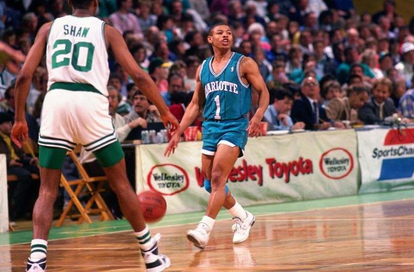 BOSTON - 1989: Muggsy Bogues #1 of the Charlotte Hornets moves the ball up court against Brian Shaw #20 of the Boston Celtics during a game played in 1989 at the Boston Garden in Boston, Massachusetts. NOTE TO USER: User expressly acknowledges and agrees that, by downloading and or using this photograph, User is consenting to the terms and conditions of the Getty Images License Agreement. Mandatory Copyright Notice: Copyright 1989 NBAE (Photo by Dick Raphael/NBAE via Getty Images)