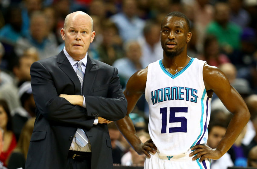 CHARLOTTE, NC - NOVEMBER 24: Head coach Steve Clifford of the Charlotte Hornets talks to Kemba Walker #15 during their game at Time Warner Cable Arena on November 24, 2014 in Charlotte, North Carolina. NOTE TO USER: User expressly acknowledges and agrees that, by downloading and or using this photograph, User is consenting to the terms and conditions of the Getty Images License Agreement. (Photo by Streeter Lecka/Getty Images)