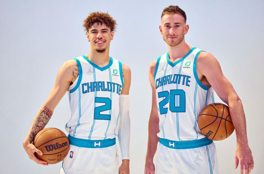 Sep 27, 2021; Charlotte, NC, USA; Charlotte Hornets guard LaMelo Ball (2) and forward Gordon Hayward (20) pose for photos during Media Day at the Spectrum Center in Charlotte, NC. Mandatory Credit: Jim Dedmon-USA TODAY Sports